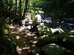 rest after hiking tour in shadowy forest