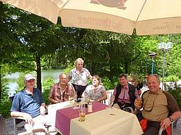 common being-together in beer garden at the summerly riverside